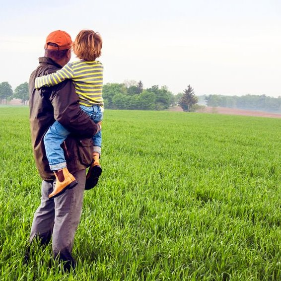 Man and son in farm field