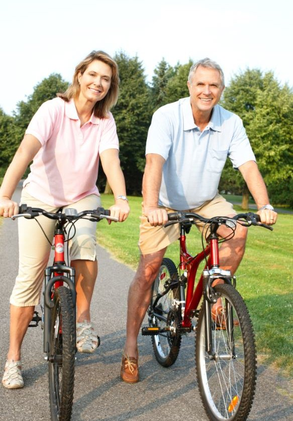 Happy couple cycling